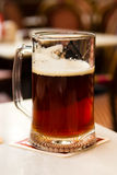 Mug of dark beer close up Stock Image