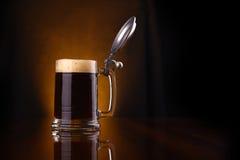 Mug of dark beer Stock Photos
