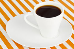 Mug of dark coffee on a saucer Stock Photo