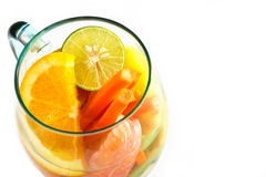 Mug delicious colorful refreshing drink of mix fruits on white background Royalty Free Stock Photo