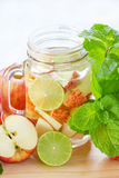 Mug delicious refreshing drink of apple fruits with mint Stock Photo