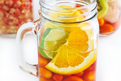 Mug delicious refreshing drink of mix fruits colorful on white background Royalty Free Stock Photography
