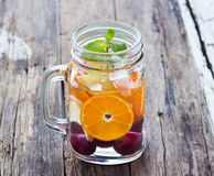 Mug delicious refreshing drink of mix fruits with mint, infusion Royalty Free Stock Photo