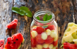 Mug delicious refreshing drink of mix fruits watermelon and cantaloupe, infusion water Stock Photo