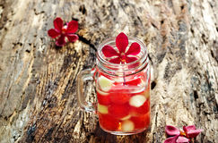 Mug delicious refreshing drink of mix fruits watermelon and cantaloupe on wooden background Stock Image
