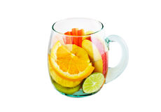 Mug delicious refreshing drink of mix fruits on white background Stock Image