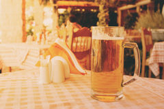 Mug of draft beer on restaurant table Royalty Free Stock Images