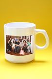 Mug with family photo Royalty Free Stock Photography