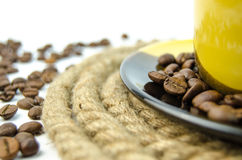 A mug filled with coffee grains Royalty Free Stock Photo