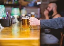 Mug filled with cold tasty beer in bar. Friday leisure tradition. Beer pub concept. Weekend lifestyle. Beer mug on bar. Counter defocused background. Glass with royalty free stock photography