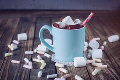 Mug filled with hot chocolate and marshmallow  and candy canes, Stock Photo