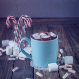 Mug filled with hot chocolate and marshmallow  and candy canes i Royalty Free Stock Image