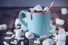 Mug filled with hot chocolate and marshmallow  and candy, toned Royalty Free Stock Image