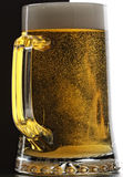 Mug of fresh beer. Glass mug of fresh light beer with froth and bubbles Royalty Free Stock Photo