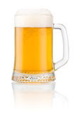 Mug fresh beer with cap of foam  on white Royalty Free Stock Image