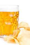 Mug of Fresh beer and Pile of potato chips Royalty Free Stock Photos