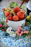 Mug with fresh berries Stock Image