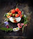 Mug with fresh berries Stock Photos