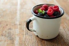 Mug with fresh fruits Royalty Free Stock Photo
