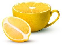 Mug of fresh lemon one cut in half royalty free stock images