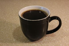 Mug with freshly brewed coffee Royalty Free Stock Photography