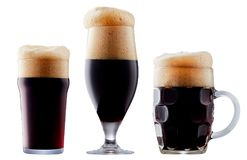 Mug of frosty dark beer with foam. Isolated on a white background Royalty Free Stock Photos