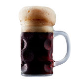 Mug of frosty dark beer with foam. Isolated on a white background Stock Photo