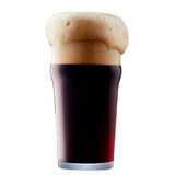 Mug of frosty dark beer with foam. Isolated on a white background Royalty Free Stock Images