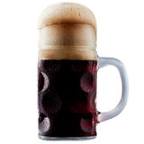 Mug of frosty dark beer with foam. Isolated on a white background Stock Photography