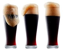 Mug of frosty dark beer with foam. Isolated on a white background Royalty Free Stock Photo