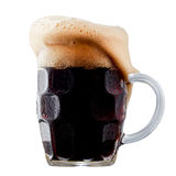 Mug of frosty dark beer with foam. Isolated on a white background Stock Photos