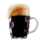 Mug of frosty dark beer with foam. Isolated on a white background Royalty Free Stock Image