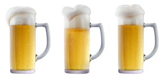 Mug of frosty beer with foam. Mug of frosty light beer with foam isolated on a white background stock photography