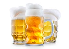 Mug of frosty beer with foam. Mug of frosty light beer with foam isolated on a white background Royalty Free Stock Photos