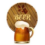 Mug of frothy beer with a barrel Stock Photos