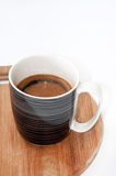 Mug full with black coffee on the wooden board Royalty Free Stock Photography