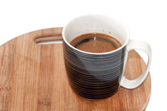 Mug full with black coffee on the wooden board Stock Photography