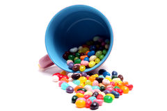 Mug full of Jelly Beans. Mug spilling jelly beans onto an isolated background Royalty Free Stock Image