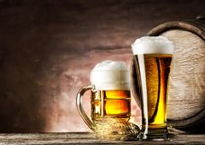 Mug and a glass of light beer Royalty Free Stock Photography
