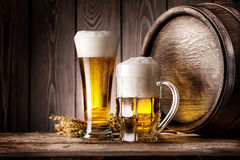 Mug and a glass of light beer with ears of barley Stock Photos