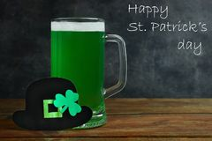 St.Patrick `s Day. Mug of green beer on a black background. Concept day of St. Patrick Stock Photo