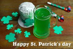 St.Patrick `s Day. Mug of green beer and clover on a wooden background. Concept day of St. Patrick Royalty Free Stock Images