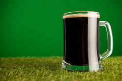 Mug of green beer on grass for St Patricks Day Royalty Free Stock Photo