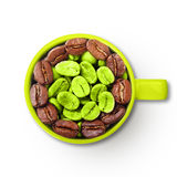 Mug with green and roasted coffee beans. Stock Photography