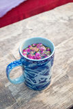 Mug of herbal tea Stock Photos