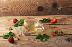 Mug with herbal tea of strawberries and strawberry Royalty Free Stock Photography