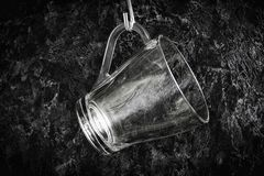 Mug on the hook. A glass mug hangs on a hook on the kitchen wall royalty free stock photography