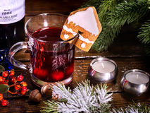 Mug hot alcohol and cookie in house form decoration drink. Top view mug of hot alcohol beverage and tasty cookie in house form decoration drink. Winter hot Stock Image