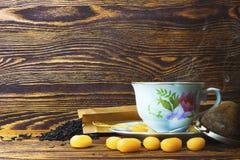 Mug of hot black tea Stock Images