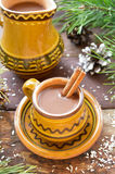 Mug of hot chocolate with cinnamon, christmas decoration Royalty Free Stock Photo